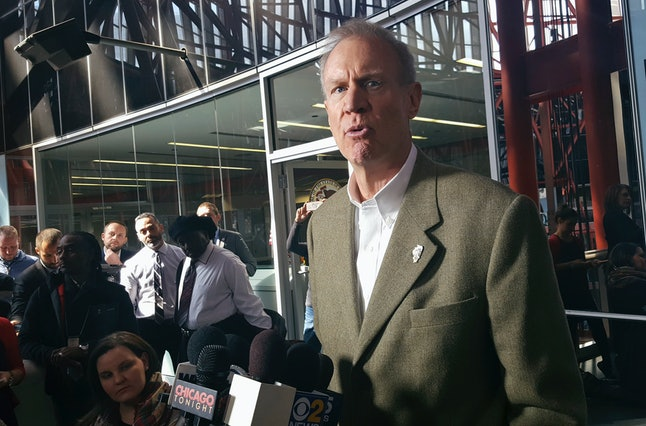 Illinois Gov. Bruce Rauner talks with reporters at the Thompson Center in Chicago.