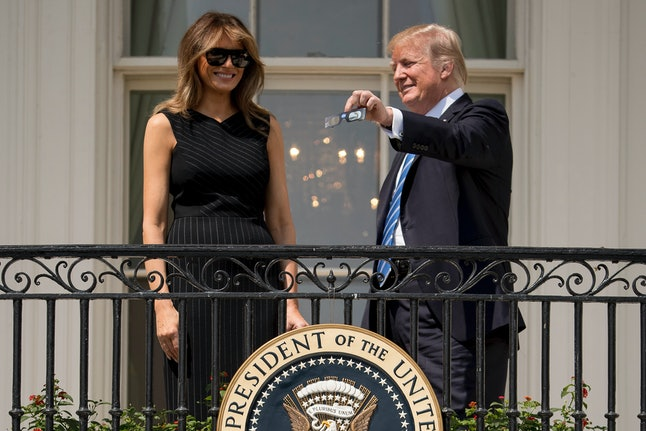 Melania Trump and her husband before the eclipse