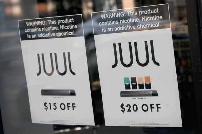 Juul signage at a local store notes the device's nicotine content.