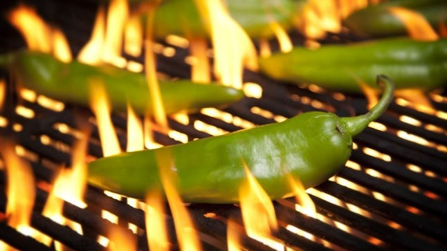 The fiery green Hatch chile, sizzling on an open flame.