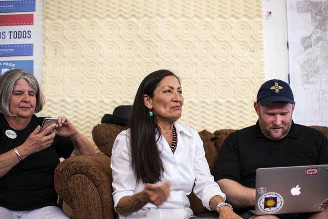 Deb Haaland, center, speaks with campaign organizers during the Democratic primary elections.