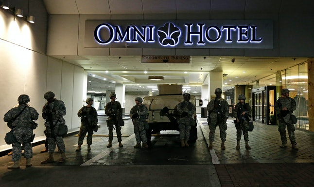Members of the North Carolina National Guard stand guard outside the Omni Hotel.