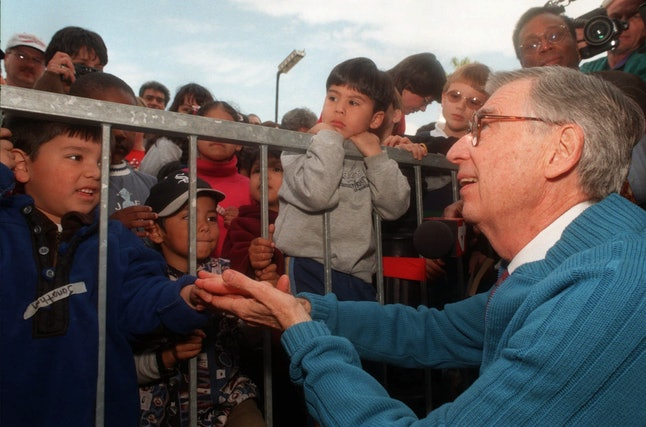 Fred Rogers greets some of his young fans after receiving a star on the Hollywood Walk of Fame on Jan. 8, 1998, in Los Angeles.