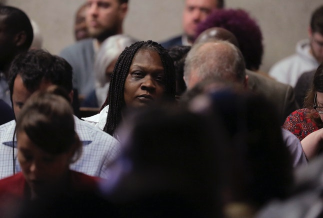 Laquan McDonald's mother, Tina Hunter, listens Tuesday during Chicago police officer Jason Van Dyke's first-degree murder trial.