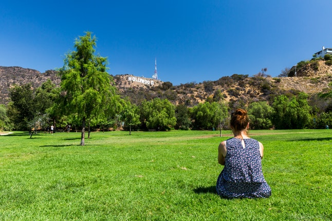Relaxing in Los Angeles in front of the Hollywood sign
