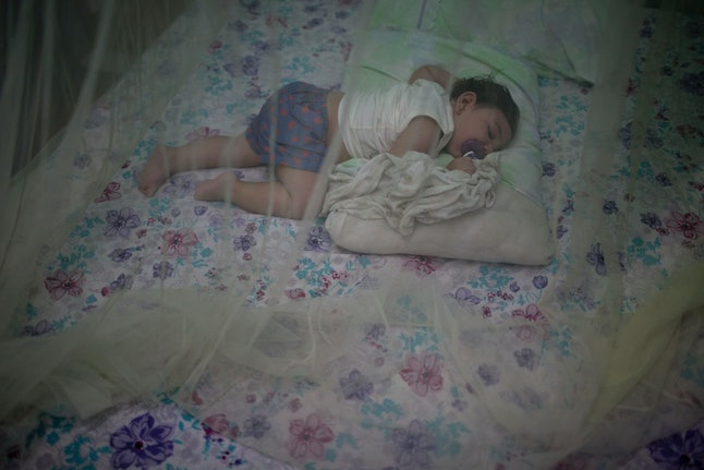 Luiza, a nearly 1-year-old baby born with microcephaly, sleeps under a mosquito net in her home in Santa Cruz do Capibaribe, Brazil.