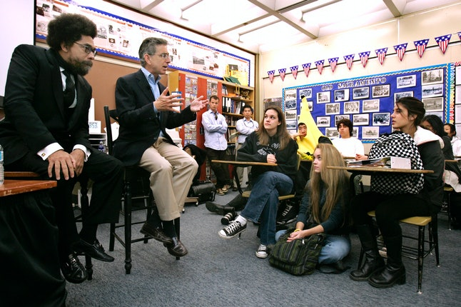 Cornel West and Democratic gubernatorial candidate, state Treasurer Phil Angelides, second from left, talk to students in a government class at John F. Kennedy High School Sacramento, Calif.,Tuesday, Oct. 31, 2006.