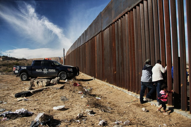 """Family members meet at the border between Mexico and the United States during the """"Keep Our Dream Alive"""" event in Ciudad Juarez, Chihuahua state, Mexico, on Dec. 10."""