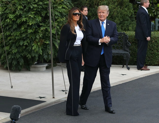 Melania Trump and her husband walk to Marine One at the White House