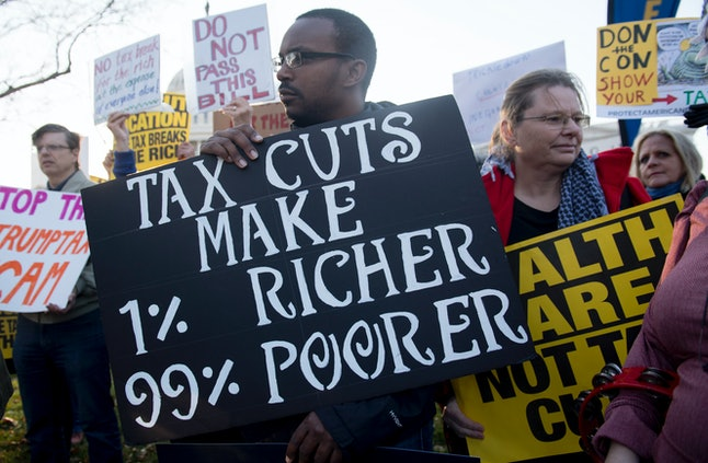 Demonstrators against the Republican tax reform bill hold a Peoples Filibuster to Stop Tax Cuts for Billionaires, protest rally outside the US Capitol on Capitol Hill in Washington, DC, November 30.