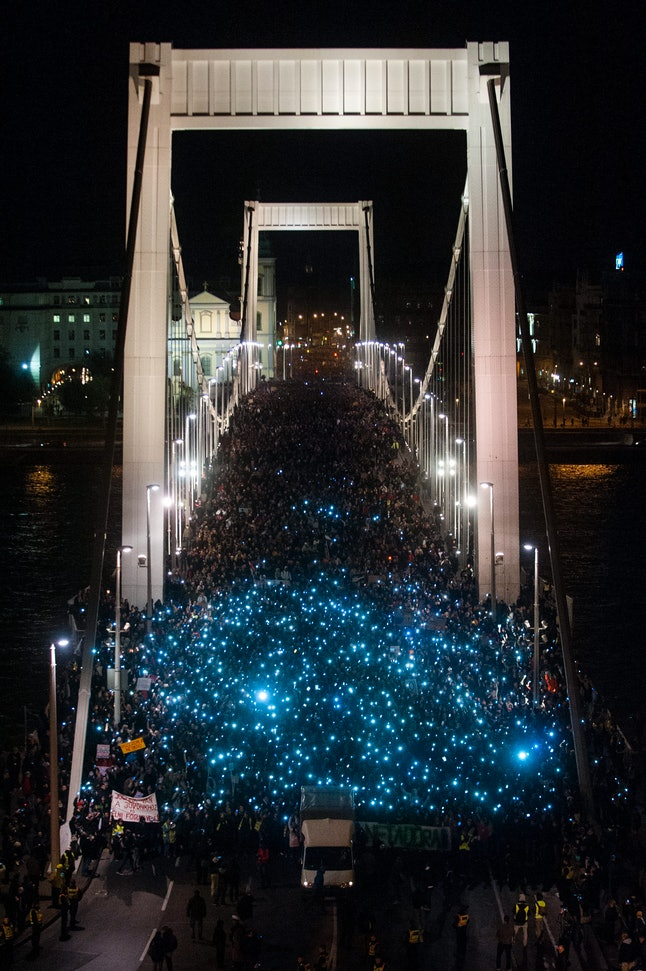 Ten of thousands of protestors marched across the Elisabeth bridge during an anti-government rally against the government's new tax plan for the introduction of the internet tax next year in Budapest on October 28, 2014.