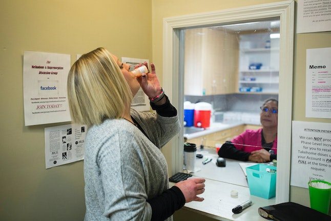 A woman in treatment for opioid addiction takes a dose of methadone at a clinic in Georgia.