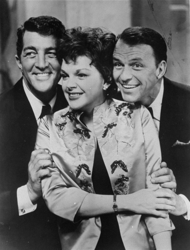 Judy Garland poses between Frank Sinatra, right, and Dean Martin at the Sands Hotel in Las Vegas, Nevada in a 1962 photo.