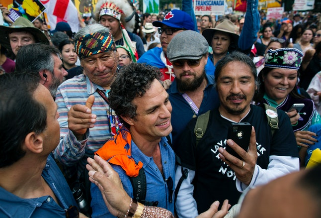 Actor and activist Mark Ruffalo, center left, and actor Leonardo DiCaprio, center right, join participants during the People's Climate March in New York Sunday, Sept. 21, 2014.