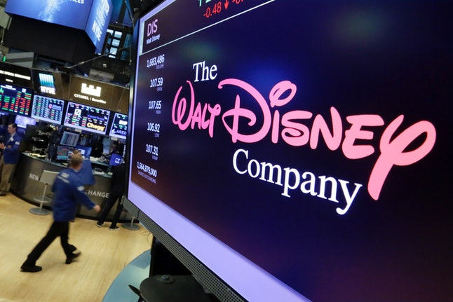 In this Monday, Aug. 7, 2017, file photo, The Walt Disney Co. logo appears on a screen above the floor of the New York Stock Exchange.