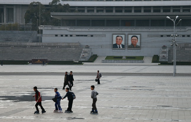 North Korean boys rollerblade on the King II Sung Square on October 26, 2014.