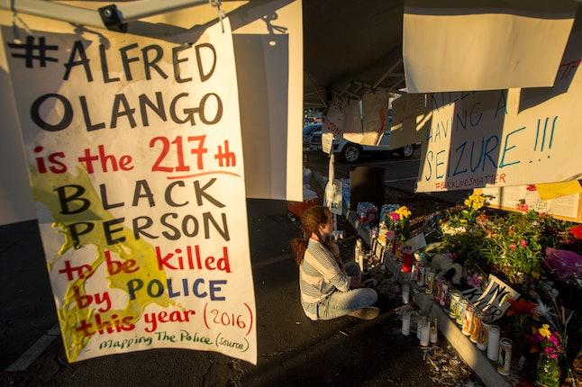 A woman visits a memorial to Alfred Olango in El Cajon, California.