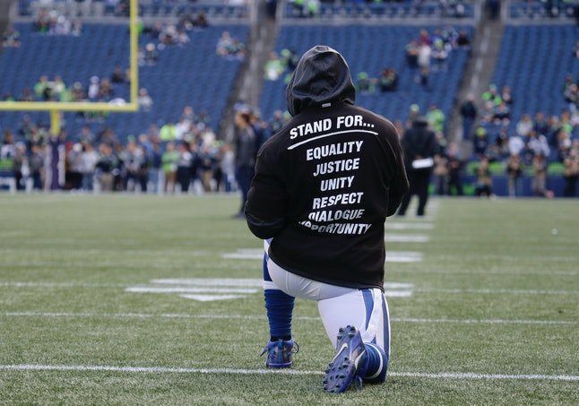 An Indianapolis Colt player kneels on the field on Oct. 1, 2017, during warmups before an NFL football game against the Seattle Seahawks in Seattle.