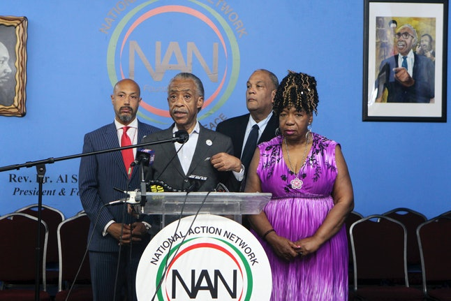 Rev. Al Sharpton, president, National Action Network, Gwen Carr, mother of Eric Garner and attorney Michael Hardy, co-founder, National Action Network attend a press conference at NAN headquarters in Harlem, New York, on July 16.