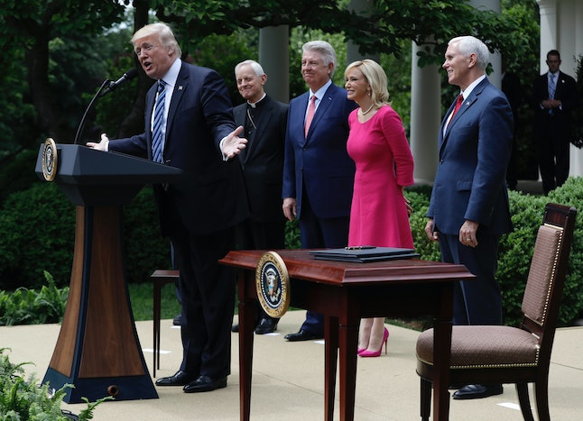 President Donald Trump speaks in the Rose Garden on May 4 before signing an executive order aimed at easing an IRS rule limiting political activity for churches. From second from left are, Cardinal Donald Wuerl is the Archbishop of Washington, Pastor Jack Graham, Paula White, senior pastor of New Destiny Christian Center in Apopka, Florida, and Vice President Mike Pence.