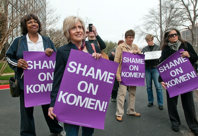 Women protested Susan G. Komen for the Cure after the charity withdrew its Planned Parenthood funding in 2012.