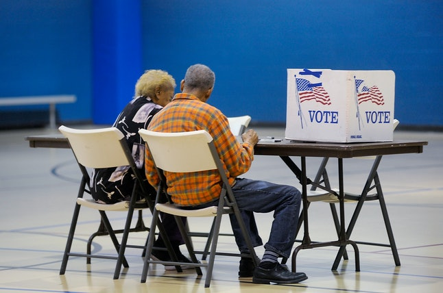 Voters read a ballot in North Carolina on Tuesday.