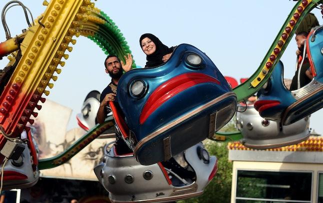 Iraqis enjoy a ride at Amusement City fairgrounds during Eid al-Adha celebrations in Baghdad, Iraq.