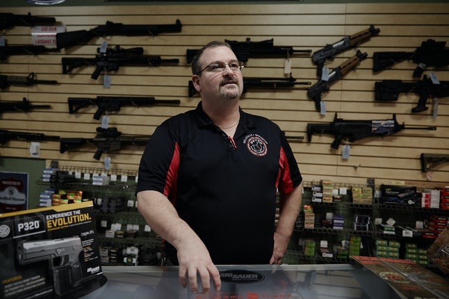 Steven King behind a counter at his gun store and training facility, Metro Shooting Supplies in Bridgeton, Missouri.