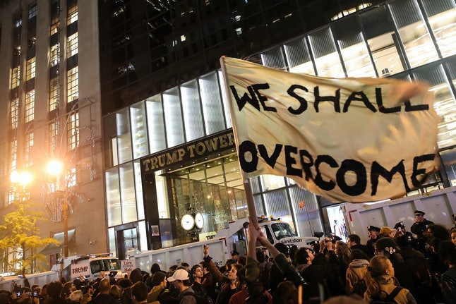 Protesters in New York City marched on Trump Tower Wednesday, protesting his positions on Muslims, LGBTQ individuals, people of color, women and immigration.