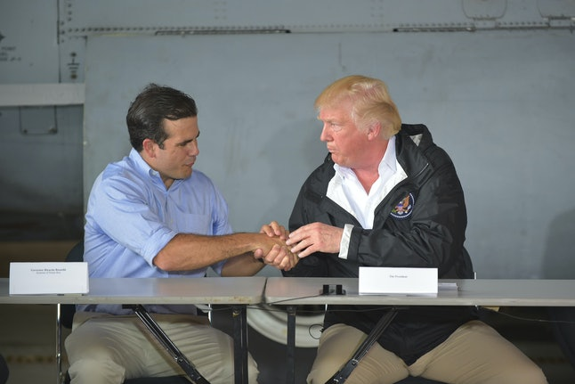 US President Donald Trump attends a meeting with Gov. Ricardo Rosselló at Muñiz Air National Guard Base in Carolina, Puerto Rico, on Oct. 3.