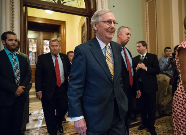 Senate Majority Leader Mitch McConnell leaves the Senate chamber on Capitol Hill on Thursday after announcing the revised version of the Republican health care bill