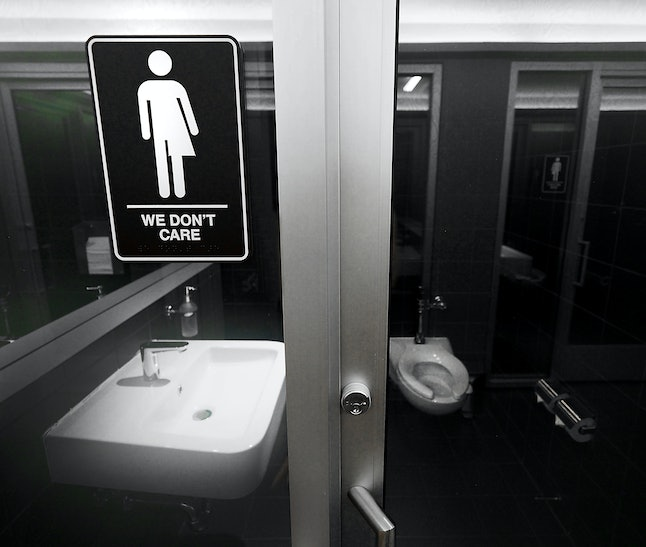Gender neutral signs are posted in the 21C Museum Hotel's public restrooms in Durham, North Carolina.