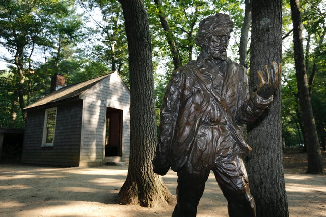 A statue of Henry David Thoreau in Concord, Massachusetts, near Walden Pond