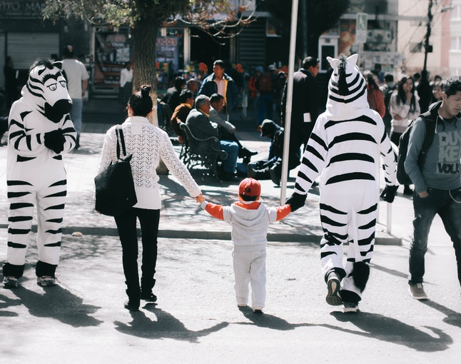 Helping a child cross the street during morning rush hour in La Paz.