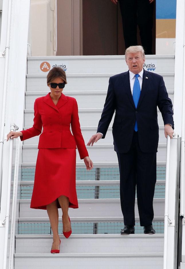 Melania Trump and her husband arriving in Paris