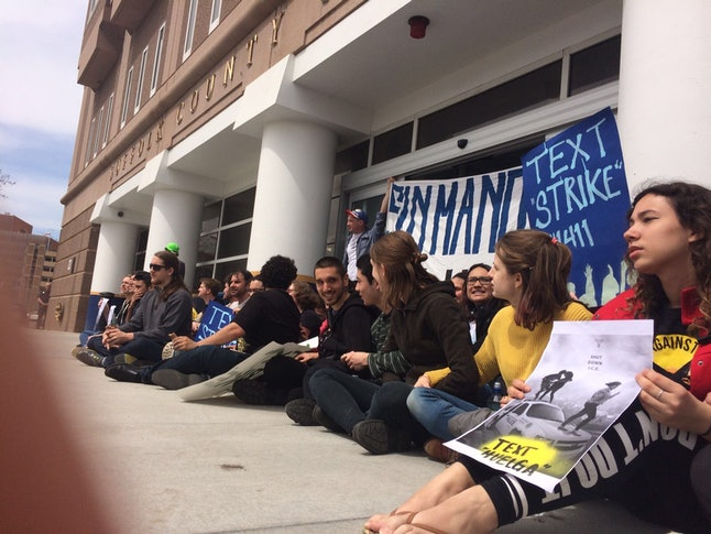 Protesters sit in at the South Bay Detention Facility in Boston
