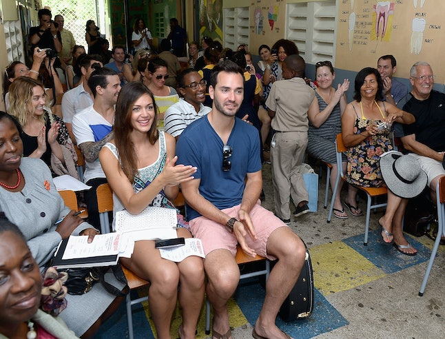Desiree Hartsock and Chris Siegfried deliver school supplies to children in Jamaica for the charity Pack for a Purpose.
