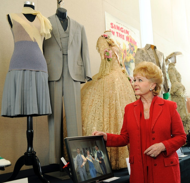 Debbie Reynolds in front of her costume collection