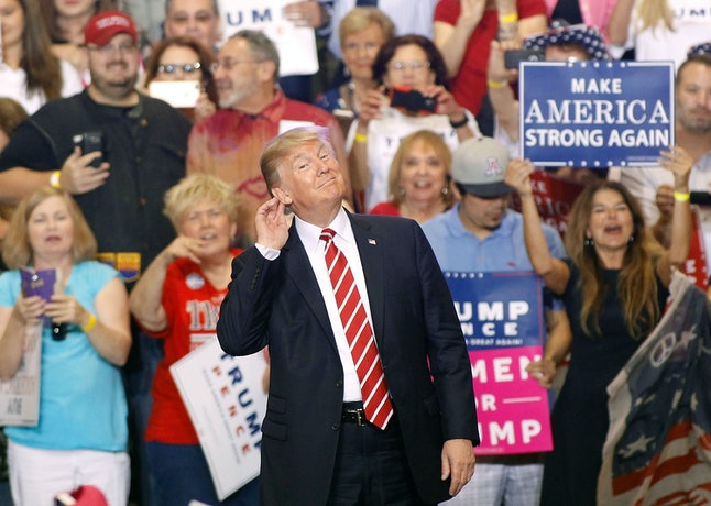 President Donald Trump gestures during a rally at the Phoenix Convention Center in Arizona on Tuesday.
