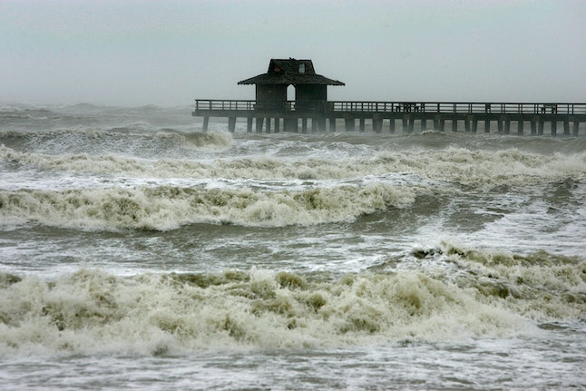 The Naples Pier is seen among the heavy waves as Hurricane Wilma passes through on October 24, 2005.