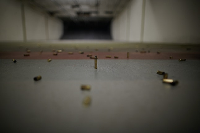 Empty shell casings litter the floor of the indoor gun range at Metro Shooting Supplies, Bridgeton, Missouri.