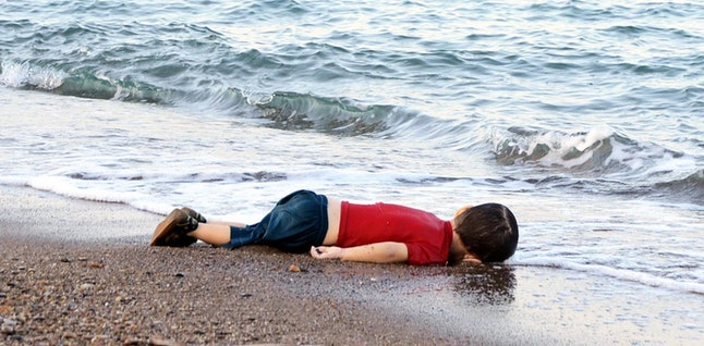 Syrian toddler Alan Kurdi's body lies on the shore in Bodrum, Turkey, after a failed attempt to flee Syria by boat.