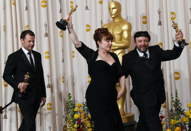 Joel Harlow, Mindy Hall and Barney Burman pose in the press room with the Oscar for best achievement in makeup for 'Star Trek' at the 82nd Academy Awards on Sunday, March 7, 2010.