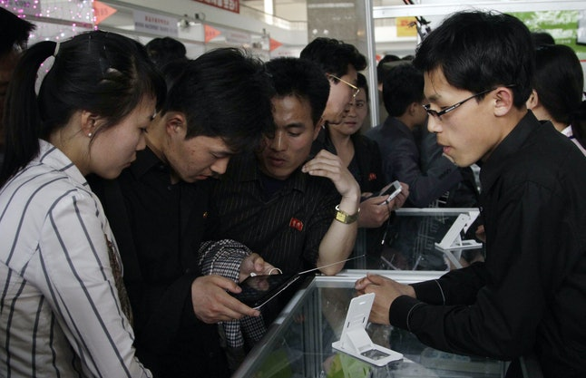 Young North Koreans take a closer look at the Samjiyon tablet on May 15, 2013.
