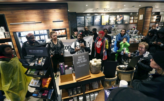 Demonstrators occupy the Starbucks that has become the center of protests on Monday in Philadelphia.