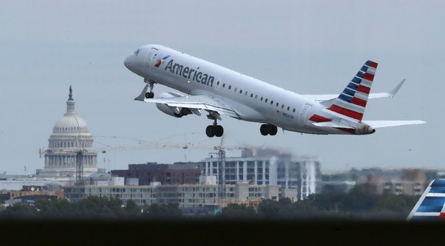 An American Airlines airplane takes off from Ronald Reagan National Airport.