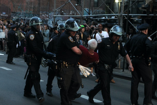 Police arrest protesters at a march for Freddie Gray.