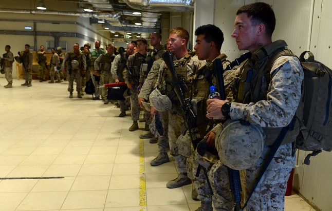 U.S. marines stand by as American and British troops prepare to withdraw from Camp Bastion on October 26, 2014.