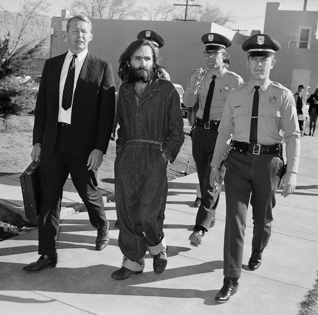 Charles Manson being escorted to court