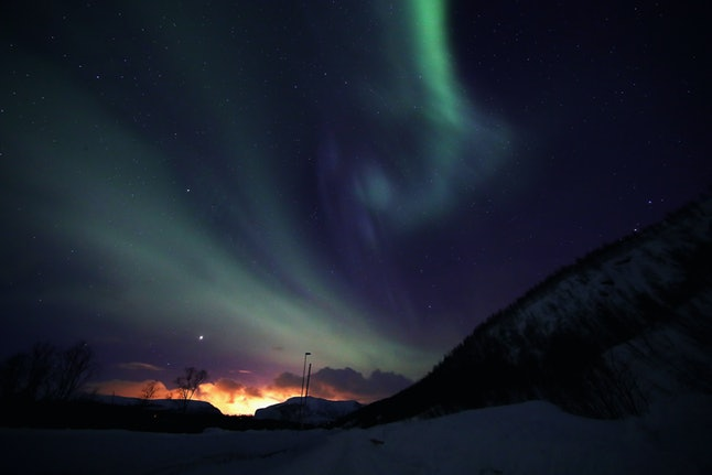 """The aurora borealis, also known as the """"northern lights,"""" appear March 29 in Finnmark, Norway."""